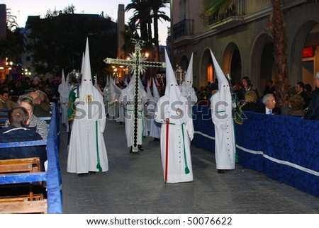 HUELVA, ANDALUSIA, SPAIN - APRIL 1: Semana Santa - Cross and Bearer in Holy Week, the traditional processions in the streets, april 1, 2010 in Huelva, Andalusia, Spain.
