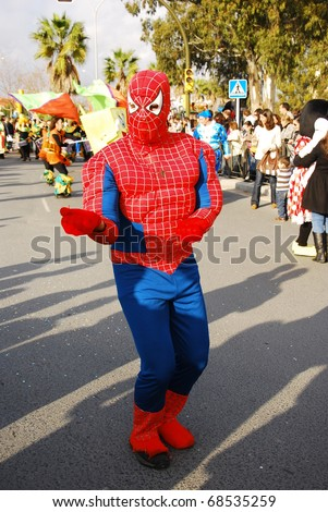 HUELVA - JANUARY 5: Three Kings, View of Spider-Man, the traditional Kings Day parade in street, january 5, 2011 in Huelva, Andalusia, Spain. - stock photo