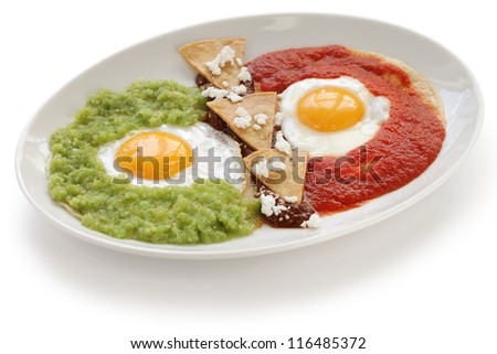 huevos divorciados, fried eggs on corn tortillas with two salsas, mexican breakfast - stock photo