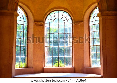 Huge arch windows in the sunshine, Castle of Tura, Hungary.