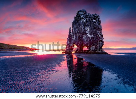 Huge basalt stack Hvitserkur on the eastern shore of the Vatnsnes peninsula. Colorful summer sunrise in northwest Iceland, Europe. Beauty of nature concept background.