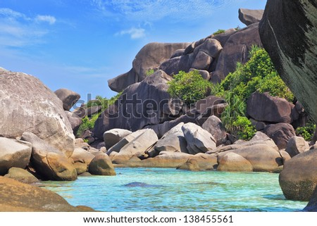 Huge beautiful reefs and cliffs on the banks of the Blue Lagoon. Rest on the Similan Islands, Thailand