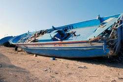 Huge broken boat of migrants. Lampedusa, Italy, 2009.