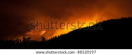 Huge bush fire at a mountain in Australia panorama #88520197