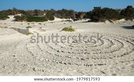 Huge circles made of stones on a white sand beach of Chrissi island, Greece
