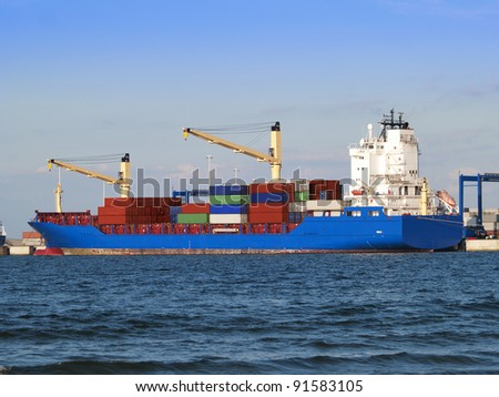 Huge container cargo ship is being unloaded
