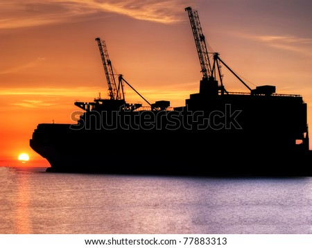 Huge container cargo  ship moored to a wharf