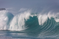 huge crashing wave breaking at waimea beach in hawaii
