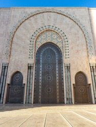 Huge decorated gate of Hassan II mosque in Casablanca, Morocco. Details of a doors with traditional arabic geometric ornament. Islamic culture