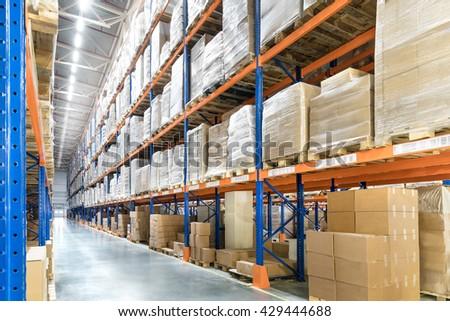 Huge distribution warehouse with high shelves. Bottom view.