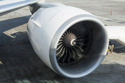 Huge engine of the Boeing 777-300ER, detailed view of the appearance of the turbine blades of an aircraft engine