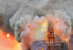 Huge fire sweeps through Notre Dame Cathedral (Paris, France) Detail of the spire before its total collapse.