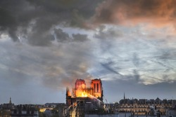 Huge fire sweeps through Notre Dame Cathedral (Paris, France) on April 2019. Here the church burning before the collapse of the spire.