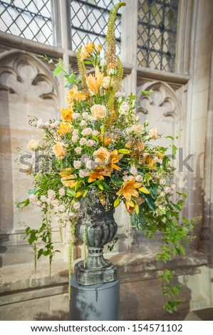 huge floral wedding bouquet arrangement on display in a church