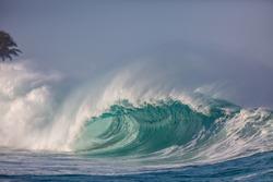 huge foamy wave breaking in hawaii