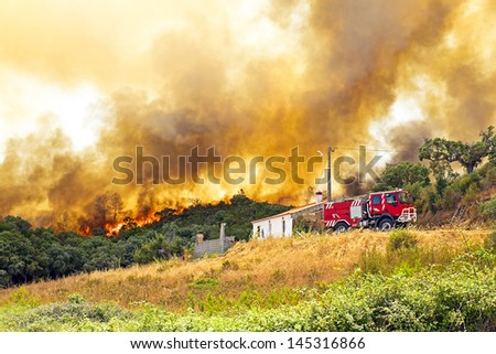 Huge forest fire threatens homes in Portugal #145316866