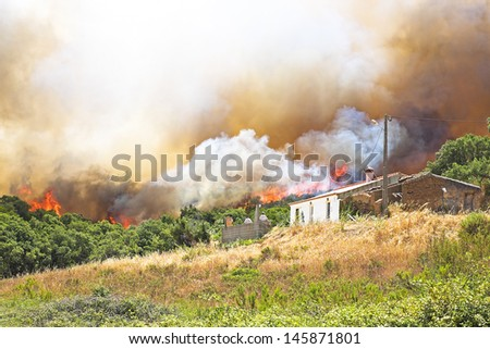 Huge forest fire threatens homes in Portugal #145871801