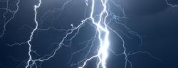 Huge fork lightnings and thunder during heavy summer storm.
