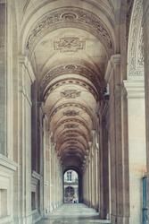 Huge giant antique vintage hall hallway. Sculpture decorated museum castle hallway passage. Classic european architecture. Postcard wallpaper. Luxury estate concept. Travel inspiration Vintage effect