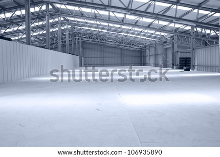 Huge gray and light warehouse with metal roof