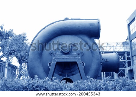 huge gray mechanical equipment in an industrial park, closeup of photo