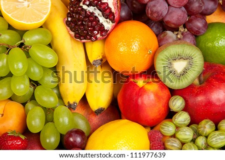 Huge group of fresh fruits isolated on a white background. Shot in a studio