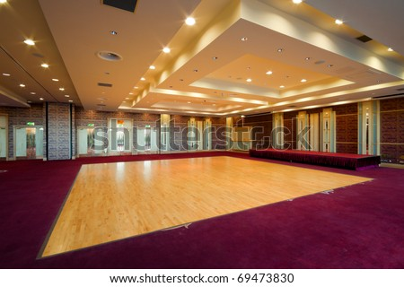 Huge Hall interior with dance floor, red carpet and ceiling with lights in Hotel