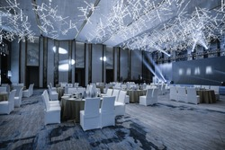 Huge Hall interior with red carpet and ceiling with lights in Hotel. elegant wedding reception table arrangement.