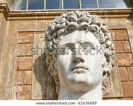 Huge head of young male sculptured in marble stone. Vatican. Vaticani museum. Rome. Italy. More of this motif & more Vatcan, Rome in my port. - stock photo