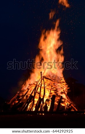 Huge hot bonfire glows in the night.    #644292925