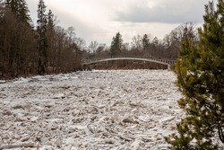 Huge ice loads into the river Ogre at the city bridge in March 2021 in Ogre in Latvia