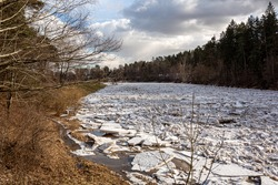 Huge ice loads into the river Ogre in March 2021  in Ogre in Latvia