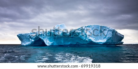 Huge iceberg in Antarctica, beautiful winter background - stock photo