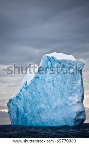 Huge iceberg in Antarctica, dark sky