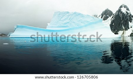 Huge iceberg in the De Gerlache Strait, west coast of antarctic peninsula, Antarctica - stock photo