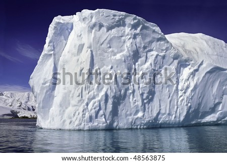 Huge iceberg on a clear sunny day at, Antarctica. - stock photo
