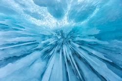 Huge icicles in the ice grotto on Lake Baikal in winter, Siberia, Russia
