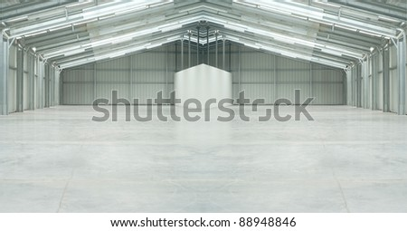 Huge light warehouse in gray with strange form