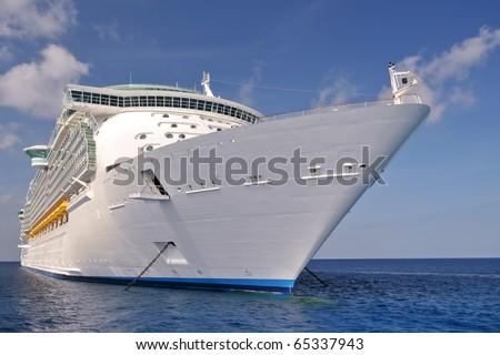 huge modern luxury cruise ship anchored off shore in ocean port