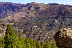 Huge mountain on the island of Gran Canaria with houses and roads on its steep slope. Canary Islands.