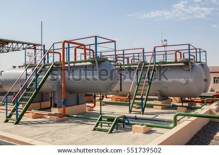Huge oil and gas storage tanks in open air