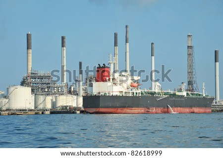Huge Oil Tanker Docked At  An Offshore Oil Refinery