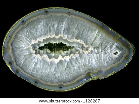 Huge open agate geode, against a black background