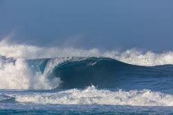 huge perfect wave breaking at pipeline beach in hawaii