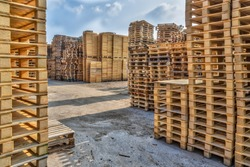 Huge piles of different type of pallet at a recycling business area
