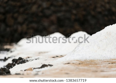 Huge piles of salt in the Salinas de Fuencaliente, La Palma, Spain with focus on the first pile.