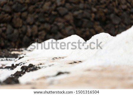 Huge piles of salt in the Salinas de Fuencaliente, La Palma, Spain with focus on the second pile.