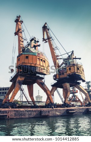 huge port cranes stand on the...