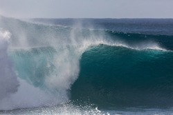 huge powerful wave breaking at pipeline beach in hawaii