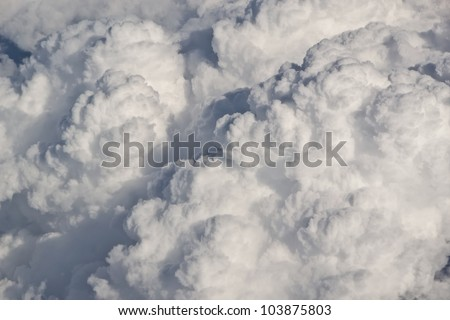 Huge rain clouds building, seen from an airplane over Denmark. - stock photo